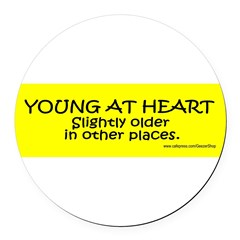 Young At Heart. Slightly older in other place Round Car Magnet